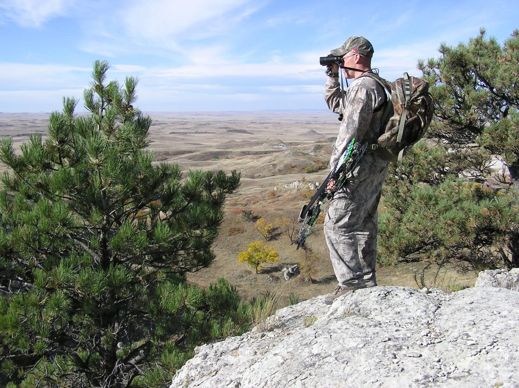 Hunter Glassing (Spotting) from Vantage Point